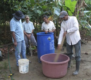 Mixing up organic pesticides on our Demo Farm